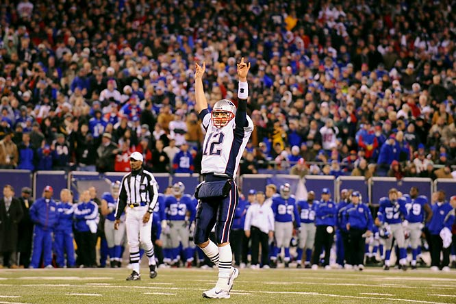 Tom Brady celebrating the win over the Giants that capped New England's 16-0 undefeated regular season.