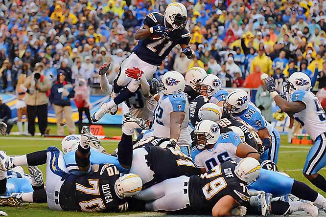 LaDainian Tomlinson finally found the end zone midway through the fourth quarter, on a fourth-down leap over the pile from inside the 1. Tomlinson was held to 42 yards on 21 carries in the game.