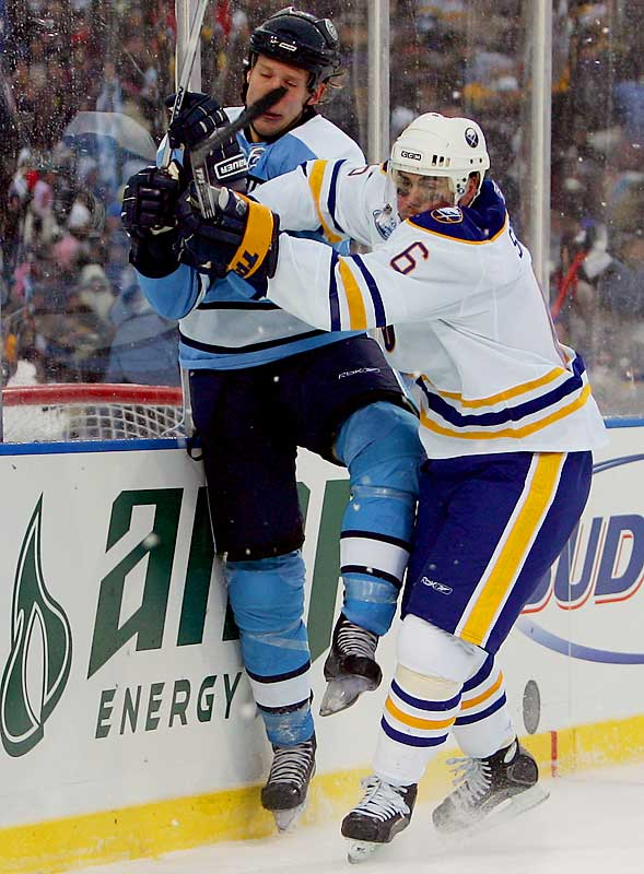Sabres' defenseman Jaroslav Spacek checks Jordan Staal into the boards, a day after Spacek was named his club's captain for January.
