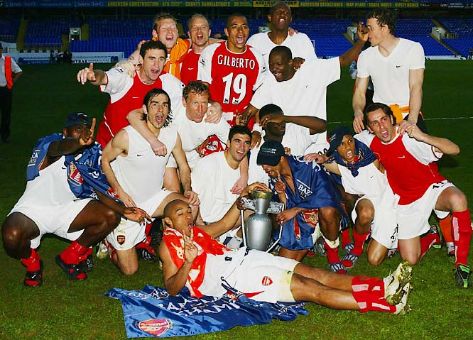 """No English club had gone through a season in the top division unbeaten since Preston North End in 1889. But 115 years later, an Arsenal side featuring Dennis Bergkamp, Thierry Henry and Patrick Vieira did just that. With the league title already in hand -- but their pristine 25-0-12 record on the line -- the Gunners slipped into a 1-0 hole against Leicester City on the final day of the season to the chagrin of their Highbury faithful. But Henry equalized on a penalty kick and team captain Vieira struck home a game-winner in the 66th minute, securing a 2-1 victory that helped """"The Invincibles"""" live up to their hyperbolic but appropriate nickname."""