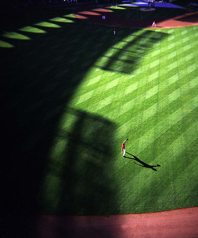 I shot this photo with a Holga, a $14 camera that runs 120 film and has a plastic lens. I love the way the shadows fall in this image made during a Cardinals practice prior to game three of the 2004 World Series vs. the Boston Red Sox.