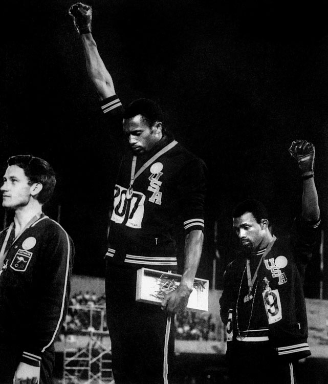 As Smith and Carlos received their 1968 Olympic gold and bronze medals, respectively, in the 200-meter sprints, the two are often remembered more for the way they received the medals: heads bowed, fists clenched and raised in the air, and wearing only black socks on their feet as the national anthem played -- a silent demonstration for human rights and black power.