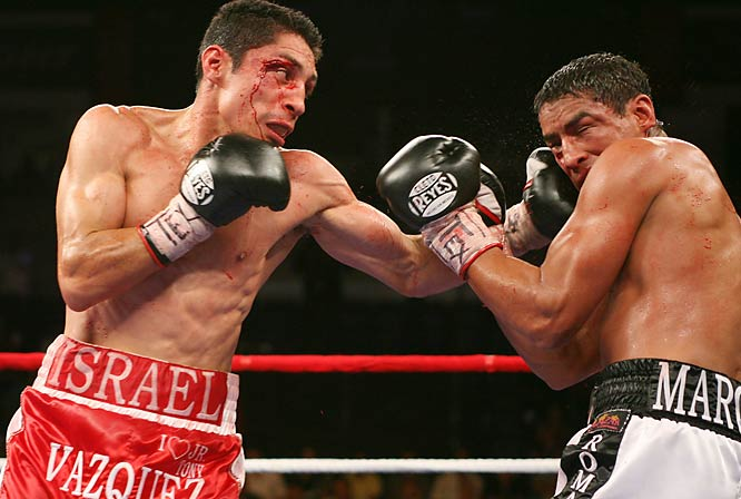Despite blood gushing from his right eye, Vazquez hung tough and banged out a sixth-round TKO.