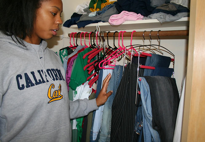 "Here Ashley shows off her stuffed closet. By her count she owns nine pairs of jeans (plus the three that she keeps in her locker at the gym). ""I have jeans issues,"" she explains."