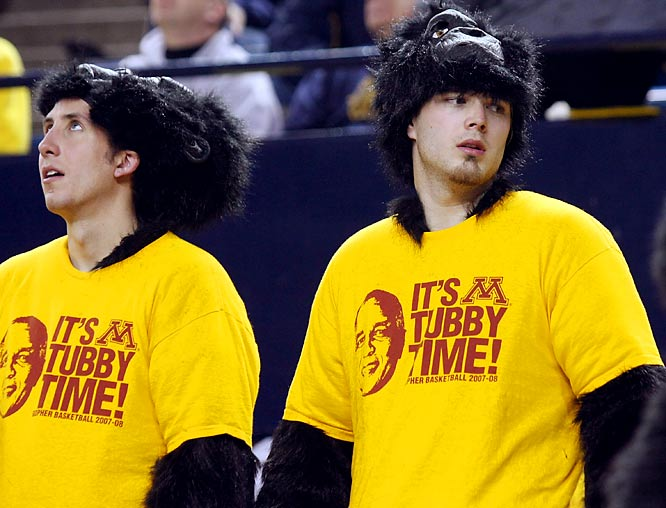 Minnesota students wear custom-made T-shirts and gorilla suits during a 77-65 victory over Michigan in Ann Arbor.
