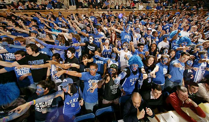 Duke fans show everyone their right arm.