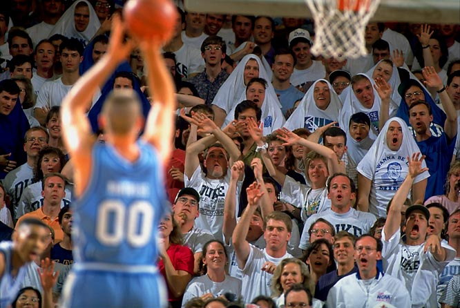 Duke fans distract former Tar Heel great Eric Montross during a 1994 game.
