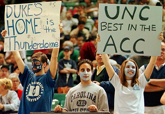 A Duke and Carolina fan show off dueling signs during a 1999 matchup between the two schools.
