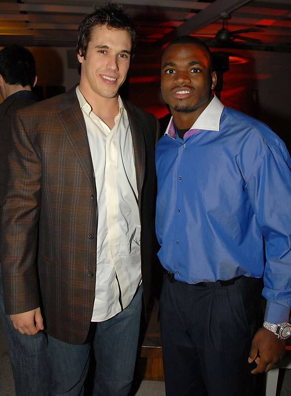 Brady Quinn managed to smile even though Adrian Peterson kept telling him about how great HIS rookie season was at last week's CAA Sports Super Bowl Party.