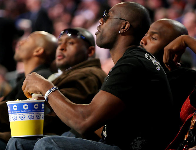 Terrell Owens, shown here at NBA All-Star Saturday Night, cannot be kept away from his popcorn.