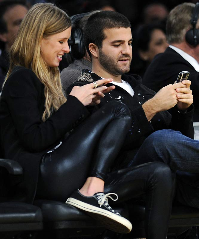 Paris Hilton's sister, Nicky, and boyfriend David Katzenberg, pay close attention to the Lakers game against the Heat on Thursday.