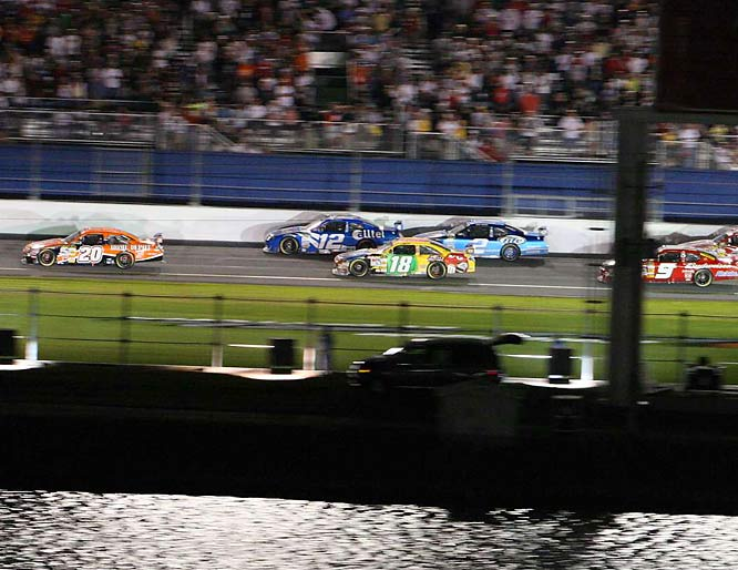 With Tony Stewart sliding down to the inside line, Kurt Busch (2) stayed behind teammate Ryan Newman (12) and helped push him to the win.