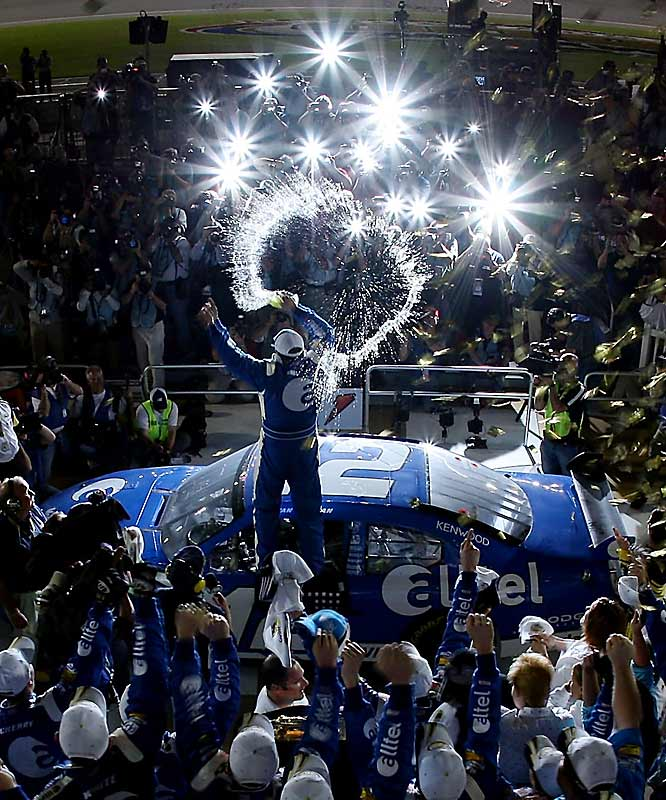 Ryan Newman leaps on top of his vehicle to celebrate his first Daytona 500 victory.