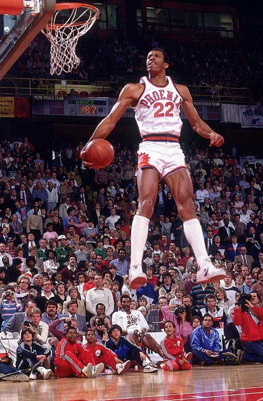 Nance was already known as one of the league's elite dunkers on the eve of the inaugural NBA dunk contest in 1984. But not until the Phoenix forward defeated the old guard -- dunk revolutionary Julius Erving -- would his legacy be secured. Nance rose to the challenge before the McNichols Arena crowd in Denver, throwing down a reverse jam, a wrap-around and a two-fisted reverse using a pair of basketballs to win the event.