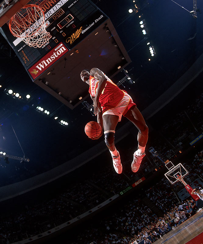 The prolific scorer and imaginative dunker won two dunk contests but remains best remembered for playing Frazier to Michael Jordan's Ali in the unforgettable 1988 contest. The Human Highlight Film wowed the Chicago crowd with his trademark windmill dunk and an off-the-glass, one-handed tomahawk -- but dropped a 147-145 decision to hometown favorite Jordan in the final round.
