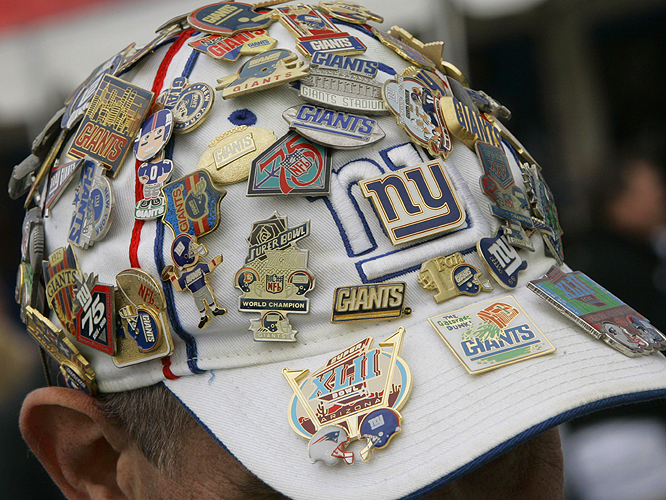 You have to wonder if Giants fan Ken Angell of Bethel, Conn., is more worried about the Patriots or the possibility of a lightning storm at Super Bowl XLII.