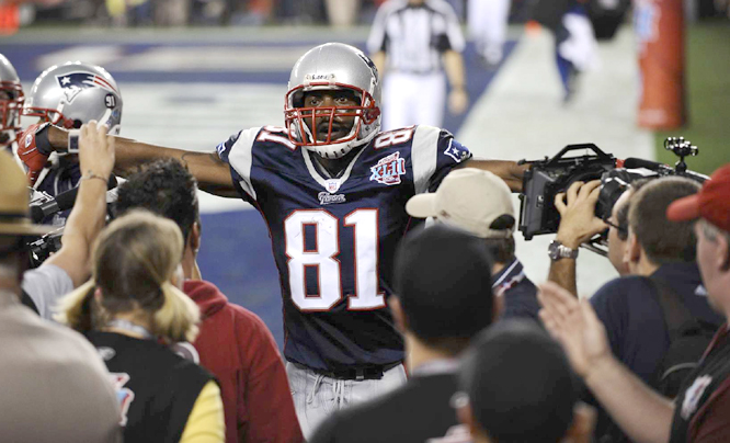 Randy Moss and Brady hooked up a record 23 times on touchdown passes during the regular season and they did it again with 2:42 left to put the Patriots up 14-10.