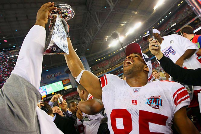 David Tyree holds the Vince Lombardi Trophy in a pose similar to his amazing catch late in the game.