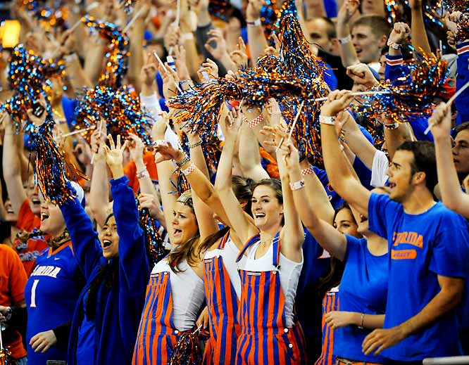 Gator fans (and their overalls) raise their hands during Florida's matchup with Tennessee last Wednesday.