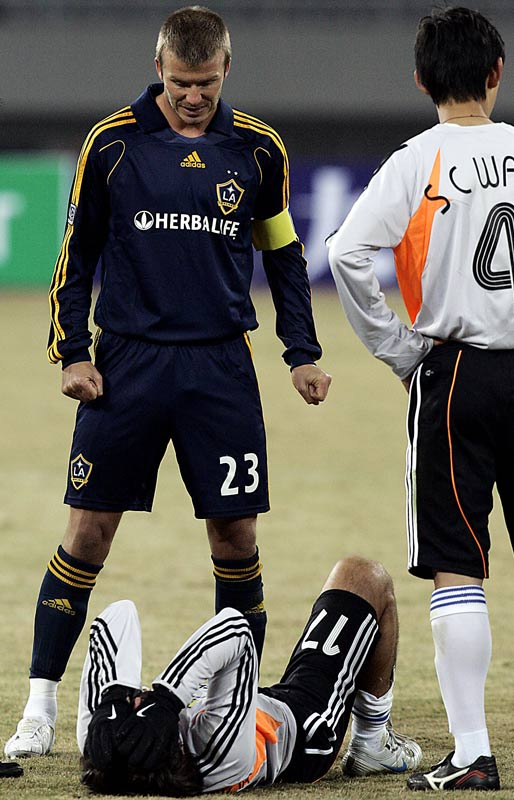 David Beckham takes care of an opponent who told him he hated the Spice Girls' music.