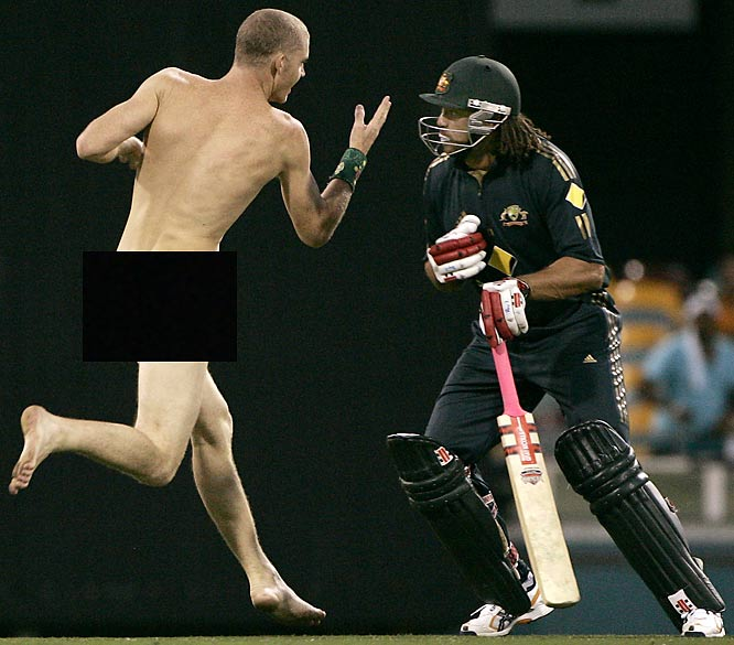 Australia's Andrew Symonds gets ready to tackle this streaker during a cricket series against India on Tuesday. Good thing he was wearing a mask.