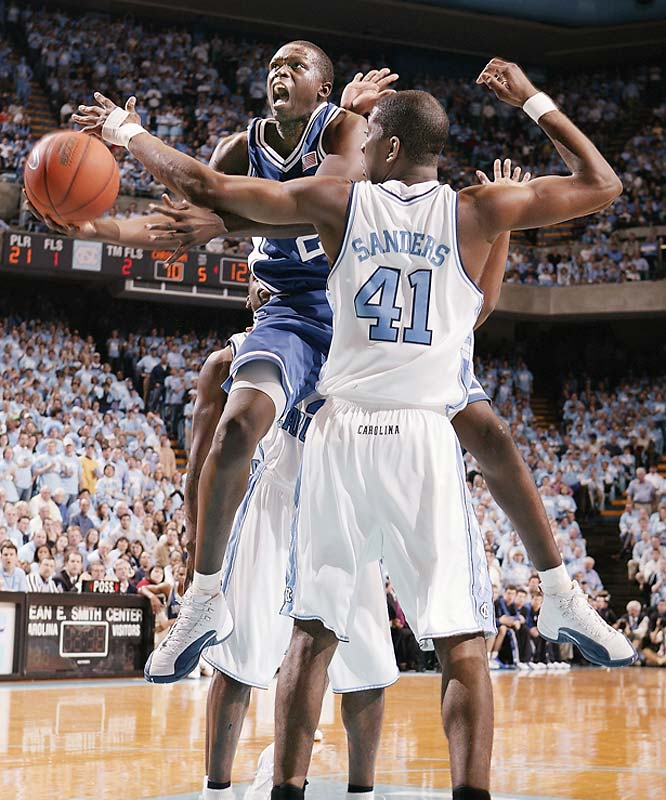 In Roy Williams' first game against Duke as the Tar Heels' head coach, UNC's Jawad Williams sends a back-and-forth game to overtime with a three-pointer late in regulation. Carolina's Rashad McCants hits another game-tying three with 13 seconds left in the extra period, but Chris Duhon races down court for a reverse layup with 6.5 seconds to play. Carolina misses at the buzzer as Duke wins for the 13th time in the past 15 games.