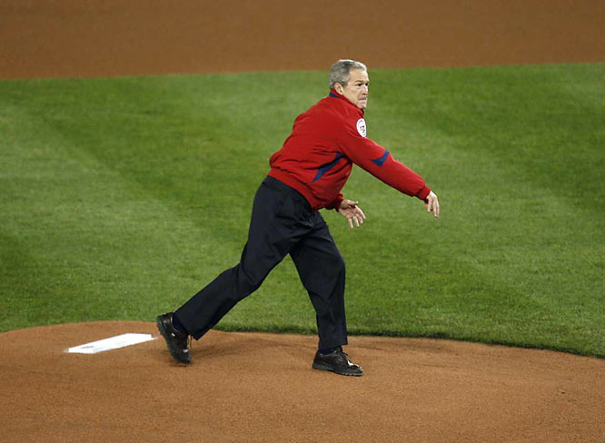 President George W. Bush throws out the ceremonial first pitch.