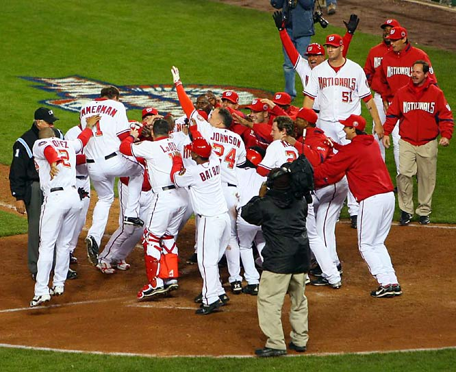 The Nationals gather around home plate to celebrate Ryan Zimmerman's game-winning home run.