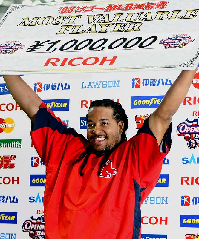 Manny Ramirez holds up the MVP award after the Red Sox beat Oakland 6-5. Ramirez hit his second two-run double in the 10th inning.