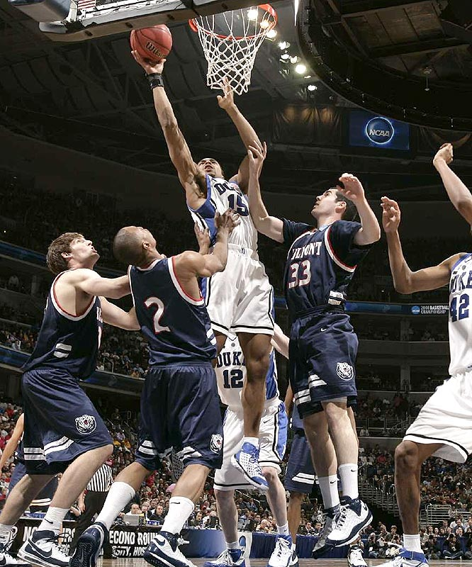 Gerald Henderson's driving basket with 11.9 seconds left erased Belmont's final lead and the Blue Devils avoided the monumental upset.