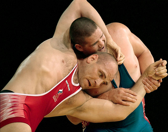 Known as the Russian Bear, Karelin competed for the Soviet Union and Russia throughout a remarkable career in the Greco-Roman discipline. He won three gold medals -- Seoul 1988, Barcelona 1992 and Atlanta 1996 -- while going undefeated in international competition from 1987 through 2000. In Sydney he suffere a shocking loss to Rulon Gardner and shortly retired.