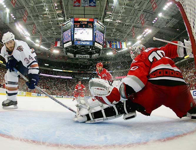It took the stellar goaltending of Conn Smythe-winner Cam Ward, a backup for most of the season, and goals from a pair of unlikely heroes -- blueliners Aaron Ward and Frantisek Kaberle -- to hold off the gallant Oilers, who made an unexpected playoff run and climbed out of a three-games-to-one Final hole with backup Jussi Markanen in net. A Chris Pronger turnover led to Justin Williams' silverware-securing tally into an empty net with 1:01 left to play.