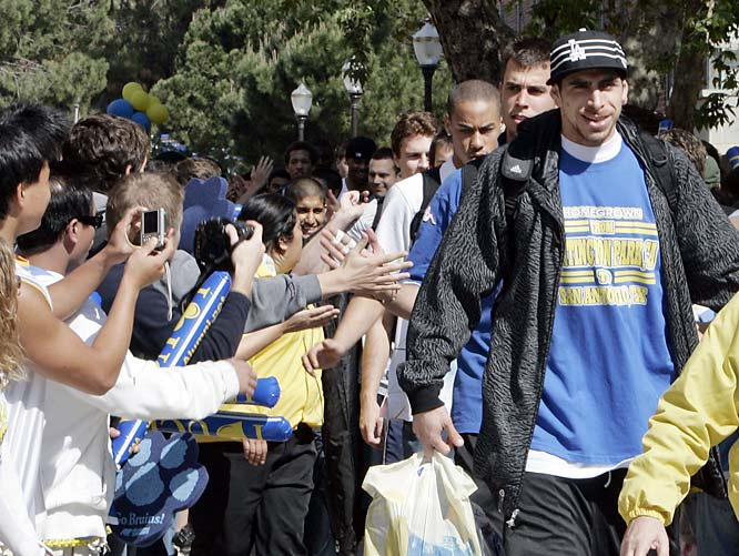 Fans applaud as the UCLA Bruin men's basketball team, lead by Lorenzo Mata-Real, marches through the campus in Los Angeles en route to the airport and the Final Four in San Antonio.