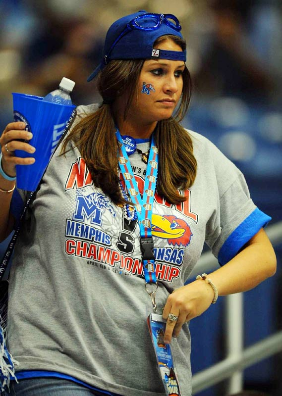 A Memphis fan gets to her seat just before tip-off of the men's final on Monday night.