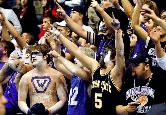Winona State fans celebrate the Warriors' 87-76 win over Augusta State in the NCAA Division II men's basketball championship.
