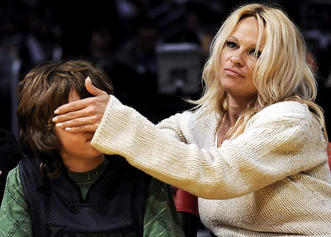 In the height of irony, Pamela Anderson shields her son Brandon from the cheerleaders during Wednesday's Lakers-Bobcats game?