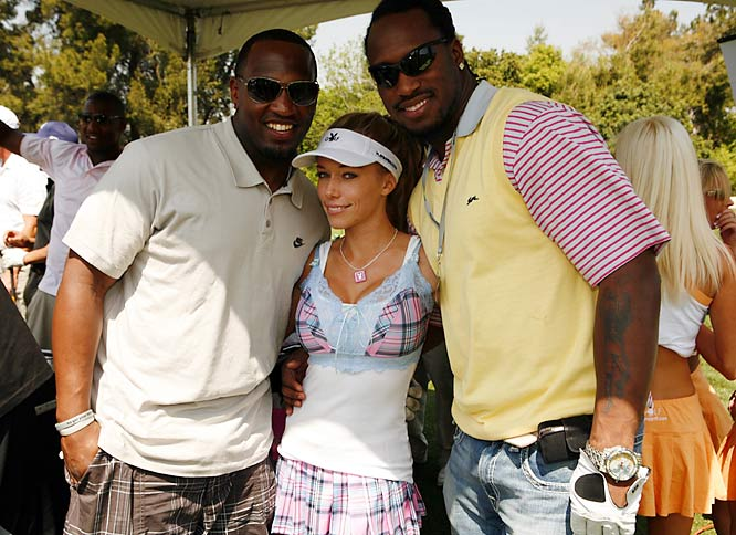 """Raiders linebacker Kirk Morrison (left), and 49ers tight end Vernon Davis are all smiles, and who can blame them as they pose with E!'s """"Girls Next Door"""" star Kendra Wilkinson at last weekend's Playboy Golf Scramble Tournament."""