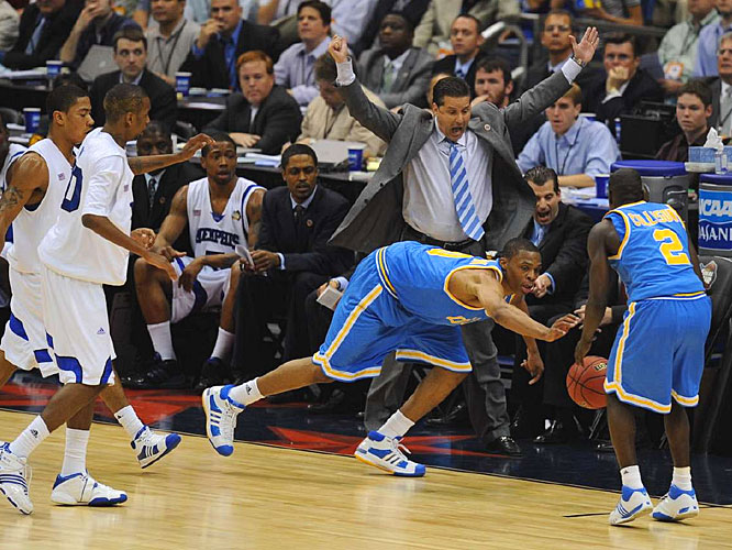 Memphis coach John Calipari tries to avoid a collision as UCLA's Russell Westbrook tries to save a loose ball to Darren Collison.