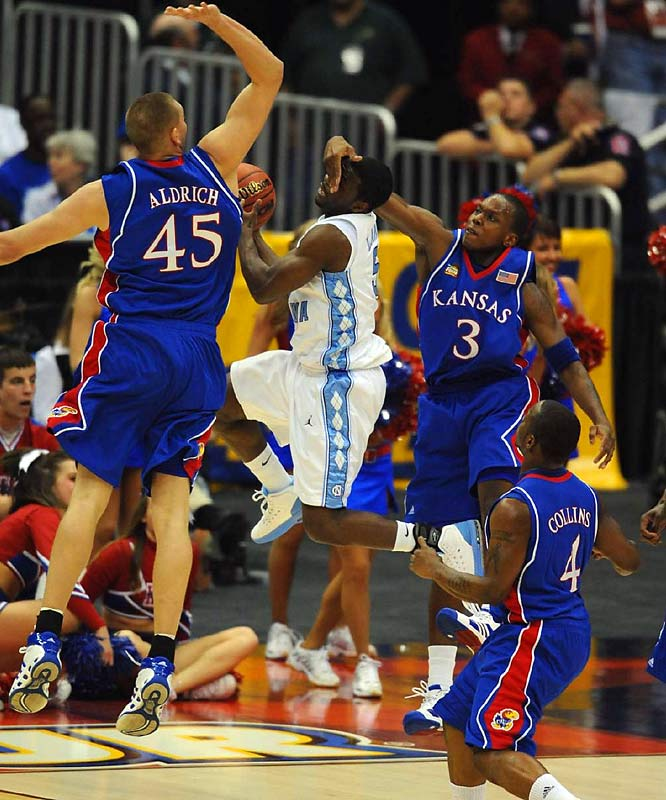 Not even Carolina's speedy point guard Ty Lawson could do much to dent the prowess of Kansas' big men.