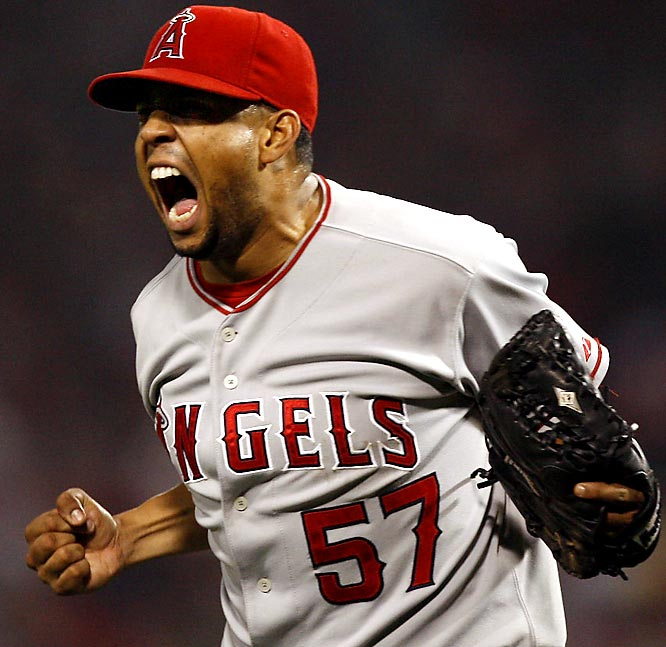 Rodriguez enjoyed a meteoric rise to stardom during the latter stages of the 2002 season with the Angels. After joining the club in mid-September thanks to a rash of injuries in the bullpen, ''K-Rod'' won five games during the playoffs -- including an 11-10 victory in Game 2 of the World Series -- despite never having won a regular-season decision in the majors. He signed with the Mets after the 2008 season.   Runner-up: Johan Santana  Worthy of consideration:  Darryl Kile and John Wetteland (Expos)