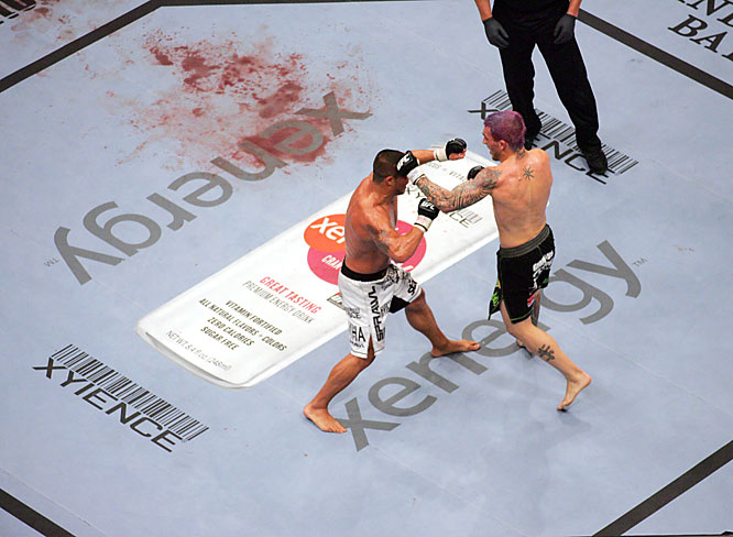 With the residuals of the Sobral-Heath fight beside him, lightweight Stevenson, left, sustained a broken bone himself (nose) as he defeated Pellegrino at UFC 74.