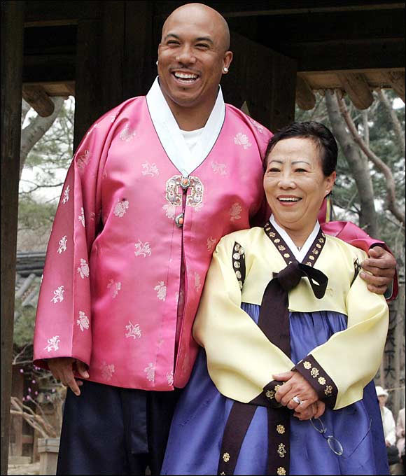 Super Bowl XL MVP Hines Ward poses with his mother, Kim Young-hee, as they wear traditional dress at the Korean Folk Village in Yongin, south of Seoul.
