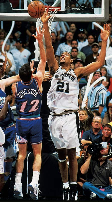 <i>1996-97</i>: 20-62 <br><i>1997-98</i>: 56-26 (36 more wins)<br><br>The return of David Robinson, who had missed all but six games the previous season with an injury, coupled with No. 1 overall pick Tim Duncan, left, vaulted the Spurs back to the top of the NBA.