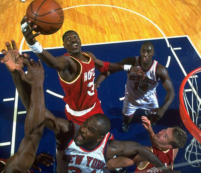 The Rockets won their first 15 games during the 1993-94 season and never looked back, storming their way to a 58-24 record and another division crown. Hakeem put together perhaps the greatest single season for a big man in league history, averaging 27.3 points, 11.9 rebounds and 3.7 blocked shots while becoming the first player to win the awards for MVP, Defensive Player of the Year and NBA Finals MVP in the same season. The Rockets edged the Knicks in seven games for Houston's first NBA championship.