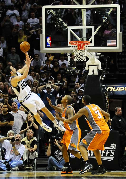Manu Ginobili seals the Spurs' double-overtime victory with a drive to the hoop.