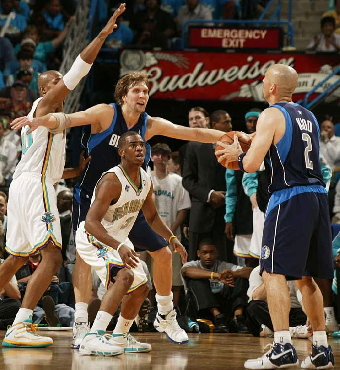 Dallas guard Jason Kidd contemplates his next move as Chris Paul of the Hornets defends.