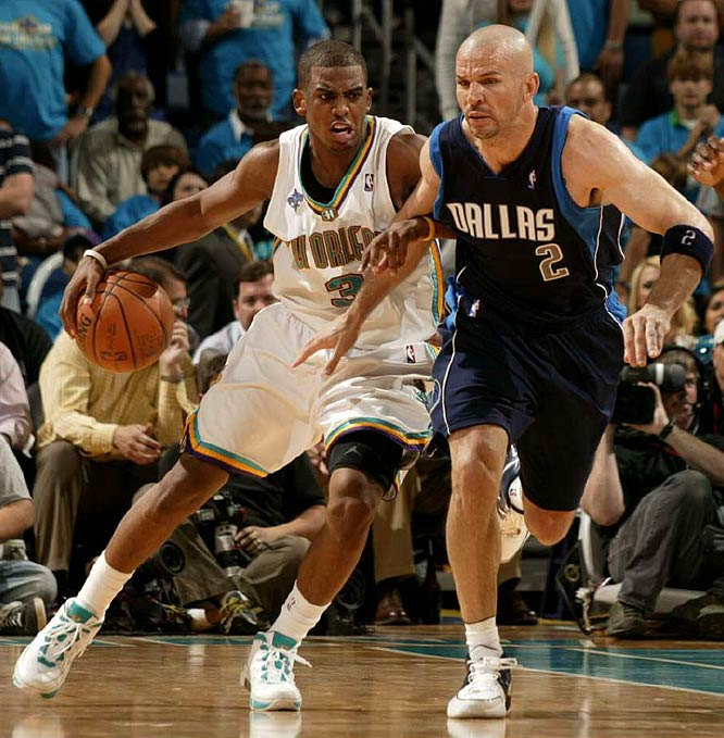 The Hornets' Chris Paul makes his move as Dallas' Jason Kidd defends.