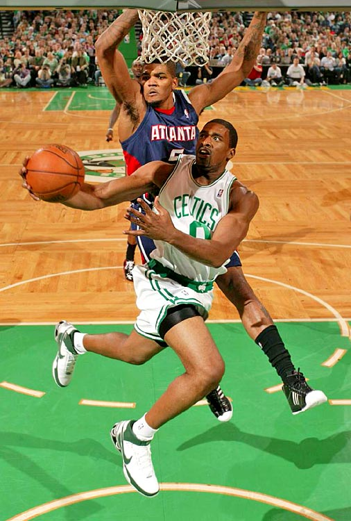 Leon Powe of the Celtics goes in for a layup against Josh Smith.