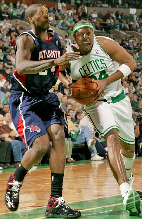 Boston's Paul Pierce drives the lane past Marvin Williams.