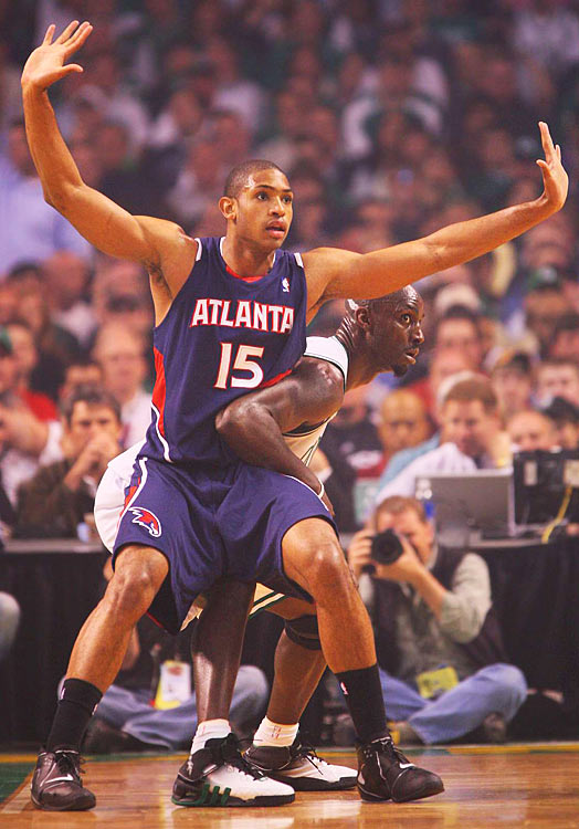 Atlanta's Al Horford and Kevin Garnett battle for post position.